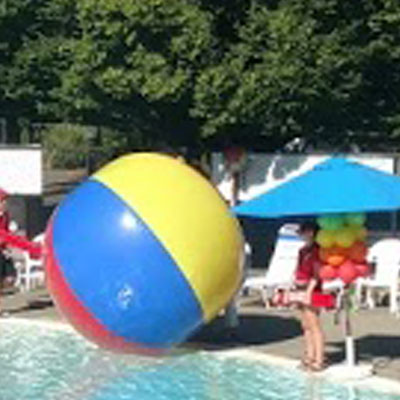 Party Factory Events - Pool Party colorful umbrellas, tables, baloons and decor